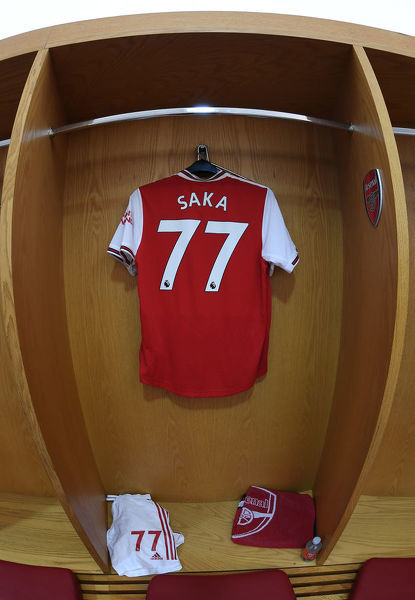 LONDON, ENGLAND - OCTOBER 06: Bukayo Saka's shirt hangs in the Arsenal changing room before the Premier League match between Arsenal FC and AFC Bournemouth at Emirates Stadium on October 06, 2019 in London, United Kingdom