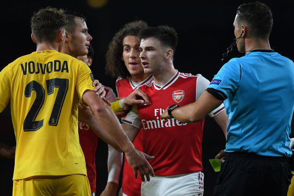 LONDON, ENGLAND - OCTOBER 03: Kieran Tierney of Arsenal clashes with Mergim Vojvoda of Standard Liege during the UEFA Europa League group F match between Arsenal FC and Standard Liege at Emirates Stadium on October 03, 2019 in London, United Kingdom