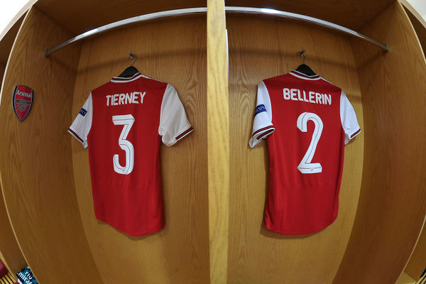 LONDON, ENGLAND - OCTOBER 03: Kieran Tieney and Hector Bellerin shirts hands in the Arsenal changing room before the UEFA Europa League group F match between Arsenal FC and Standard Liege at Emirates Stadium on October 03, 2019 in London, United Kingdom