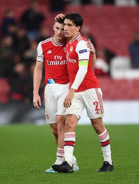 LONDON, ENGLAND - OCTOBER 03: Hector Bellerin and Kieran Tierney of Arsenal after the UEFA Europa League group F match between Arsenal FC and Standard Liege at Emirates Stadium on October 03, 2019 in London, United Kingdom
