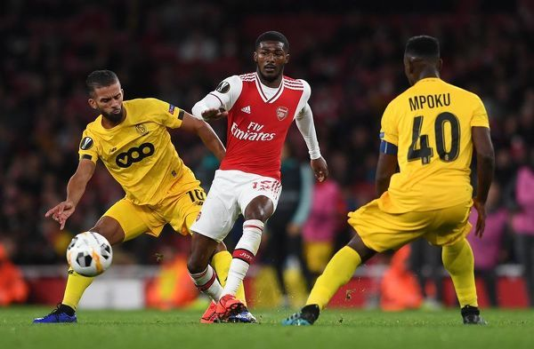 LONDON, ENGLAND - OCTOBER 03: Ainsley Maitland-Niles of Arsenal under pressure from Mehdi Carcela of Liege during the UEFA Europa League group F match between Arsenal FC and Standard Liege at Emirates Stadium on October 03, 2019 in London, United Kingdom