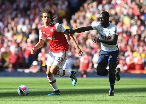 LONDON, ENGLAND - SEPTEMBER 01: Matteo Guendouzi of Arsenal takes on Davinson Sanchez of Tottenham during the Premier League match between Arsenal FC and Tottenham Hotspur at Emirates Stadium on September 01, 2019 in London, United Kingdom