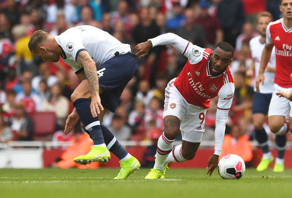 LONDON, ENGLAND - SEPTEMBER 01: Alexandre Lacazette of Arsenal takes on Toby Alderweireld of Tottenham during the Premier League match between Arsenal FC and Tottenham Hotspur at Emirates Stadium on September 01, 2019 in London, United Kingdom