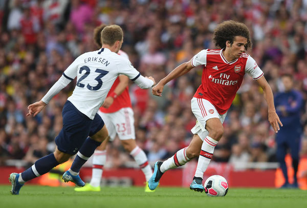 LONDON, ENGLAND - SEPTEMBER 01: Matteo Guendouzi of Arsenal takes on Christian Eriksen of Tottenham during the Premier League match between Arsenal FC and Tottenham Hotspur at Emirates Stadium on September 01, 2019 in London, United Kingdom