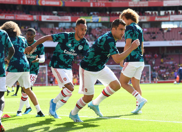LONDON, ENGLAND - SEPTEMBER 01: Sokratis of Arsenal warms up before the Premier League match between Arsenal FC and Tottenham Hotspur at Emirates Stadium on September 01, 2019 in London, United Kingdom