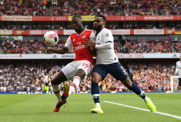 LONDON, ENGLAND - SEPTEMBER 01: Nicolas Pepe of Arsenal is challenged by Danny Rose of Tottenham during the Premier League match between Arsenal FC and Tottenham Hotspur at Emirates Stadium on September 01, 2019 in London, United Kingdom