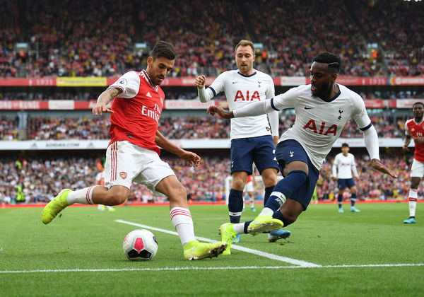 LONDON, ENGLAND - SEPTEMBER 01: Dani Ceballos of Arsenal takes on Danny Rose of Tottenham during the Premier League match between Arsenal FC and Tottenham Hotspur at Emirates Stadium on September 01, 2019 in London, United Kingdom