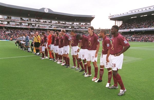 the arsenal team lines up before the match