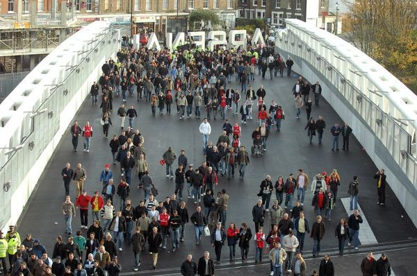 fans use the clock end bridge to get to the stadium