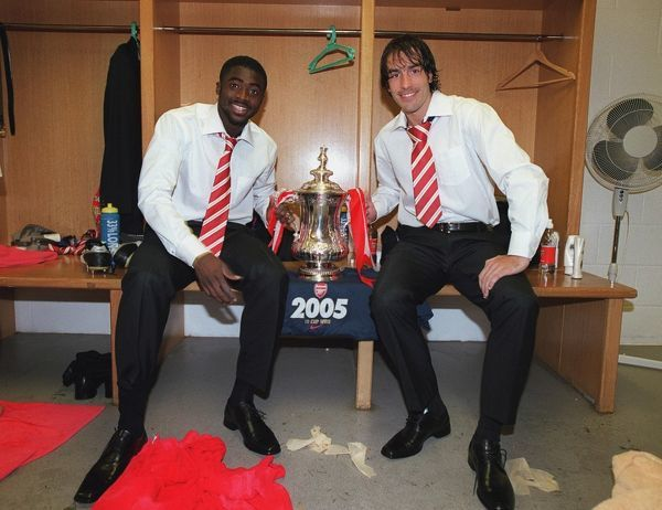kolo toure and robert pires arsenal with the fa cup after the match