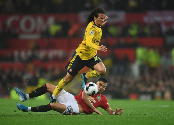 MANCHESTER, ENGLAND - SEPTEMBER 30: Matteo Guendouzi of Arsenal is fouled by Andreas Pereira of Man Utd during the Premier League match between Manchester United and Arsenal FC at Old Trafford on September 30, 2019 in Manchester, United Kingdom