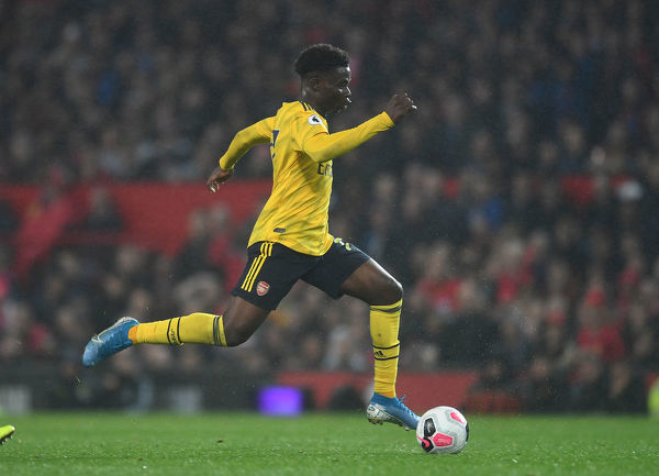 MANCHESTER, ENGLAND - SEPTEMBER 30: Bukayo Saka of Arsenal during the Premier League match between Manchester United and Arsenal FC at Old Trafford on September 30, 2019 in Manchester, United Kingdom