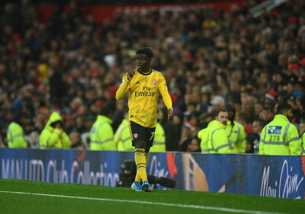 MANCHESTER, ENGLAND - SEPTEMBER 30: Bukayo Saka of Arsenal walks tothe dug out after being substituted during the Premier League match between Manchester United and Arsenal FC at Old Trafford on September 30, 2019 in Manchester, United Kingdom