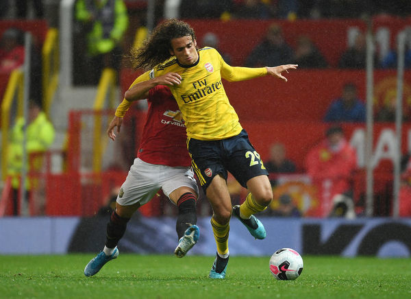 MANCHESTER, ENGLAND - SEPTEMBER 30: Matteo Guendouzi of Arsenal challenged by Andreas Pereira of Man United during the Premier League match between Manchester United and Arsenal FC at Old Trafford on September 30, 2019 in Manchester, United Kingdom