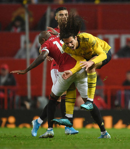 MANCHESTER, ENGLAND - SEPTEMBER 30: Matteo Guendouzi of Arsenal is fouled by Ashley Young of Man United during the Premier League match between Manchester United and Arsenal FC at Old Trafford on September 30, 2019 in Manchester, United Kingdom
