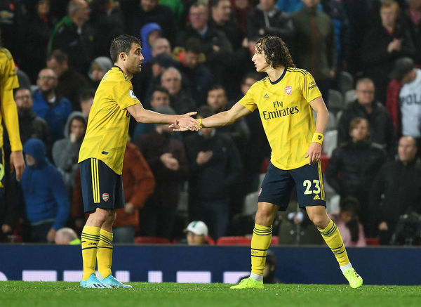 MANCHESTER, ENGLAND - SEPTEMBER 30: (L-R) Sokratis and David Luiz of Arsenal shake hands after the Premier League match between Manchester United and Arsenal FC at Old Trafford on September 30, 2019 in Manchester, United Kingdom