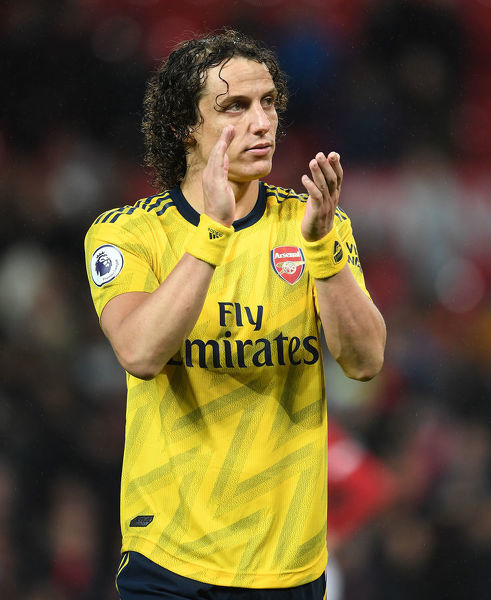 MANCHESTER, ENGLAND - SEPTEMBER 30: David Luiz applauds the Arsenal fans after the Premier League match between Manchester United and Arsenal FC at Old Trafford on September 30, 2019 in Manchester, United Kingdom