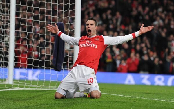 robin van persie celebrates scoring the 2nd arsenal goal arsenal 30 wigan athletic