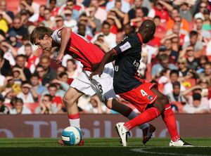 Alex Hleb (Arsenal) Youssuf Mulumbu (PSG)