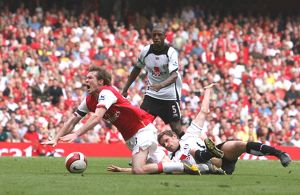 Alex Hleb is brought down for a penalty by Fulham defender Moritz Volz