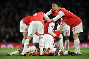 Alex Song celebrates scoring Arsenal's 1st goal with his team mates including Samir Nasri
