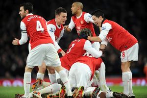 Alex Song celebrates scoring Arsenal's 1st goal with his team mates