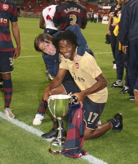 Alex Song and Tomas Rosicky celebrate the Arsenal victory