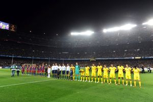 the arsenal and barcelona teams line up before the match