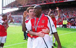 Arsenal defenders Martin Keown and Sol Campbell celebrate after the match