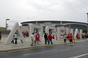 Arsenal fans gather outside the Emirates Stadium on thegiant letters near the south bridge