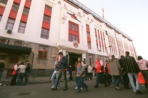Arsenal fans walk outside the East Stand before the match