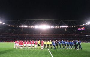 the arsenal and hamburg teams line up before