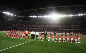 the arsenal and liege teams line up with