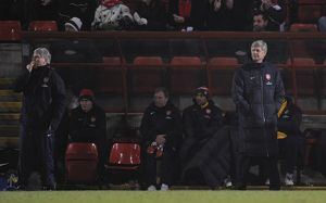 arsenal manager arsene wenger and assistant pat rice