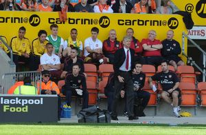 arsenal manager arsene wenger on the bench blackpool