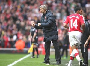 Arsenal manager Arsene Wenger celebrates the 2nd goal Arsenal 2