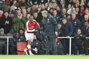 Arsenal manager Arsene Wenger congratulates Jay Simpson