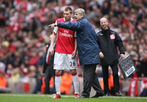 Arsenal manager Arsene Wenger with Nicklas Bendtner during the match
