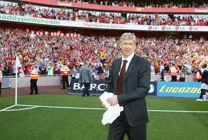 Arsenal manager Arsene Wenger waves to the fans after the match