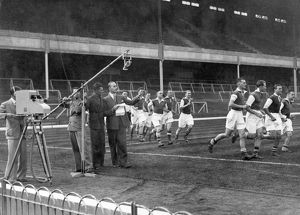 The Arsenal players in sprint practise past the Emitron Camera