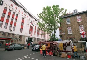 Arsenal Stadium with a house on Conewood Street with Arsenal posters in the windows