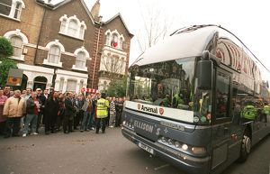 The Arsenal Team Coach arrives outside the East Stand on Avenell Road