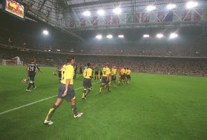 the arsenal team walk out onto the pitch