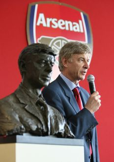 Arsene Wenger the Arsenal Manager with his bust