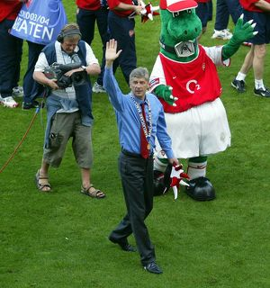 Arsene Wenger the Arsenal Manager celebrates at the end of the match