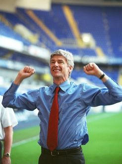 Arsene Wenger the Arsenal Manager celebrates winning the League