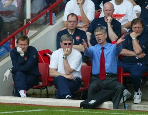 Arsene Wenger the Arsenal manager and Pat Rice his assistant