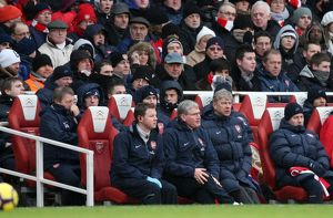Arsene Wenger the Arsenal Manager sits with Colin Lewin (Physio) and Pat Rice