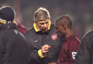 Arsene Wenger the Arsenal manager talks to Kerrea Gilbert (Arsenal) before the start of extra time