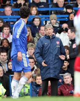 Arsene Wenger the Arsenal Manager talks to Michael Ballack (Chelsea)